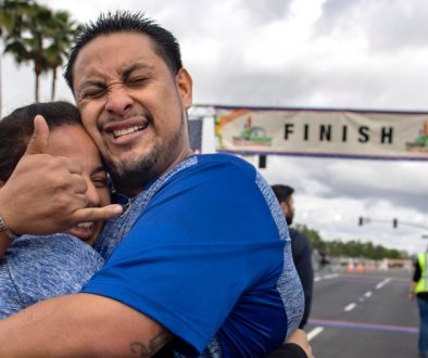 "Fernando Escobar is overcome with emotion after finishing his first half marathon in Tustin on Sunday, March 3, 2019. Nine months ago Escobar was living under a bridge in Redlands, addicted to methamphetamine and alcohol. ""I feel like I defeated a monster,"" he said of finishing the race. He hugs Angelina Cabrera. Both are living at the OC Rescue Mission's Village of Hope. (Photo by Mindy Schauer, Orange County Register/SCNG)"